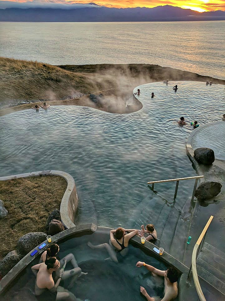 GeoSea - visiting geothermal pools in Iceland. Looking over the pool to the ocean from a hot tub.