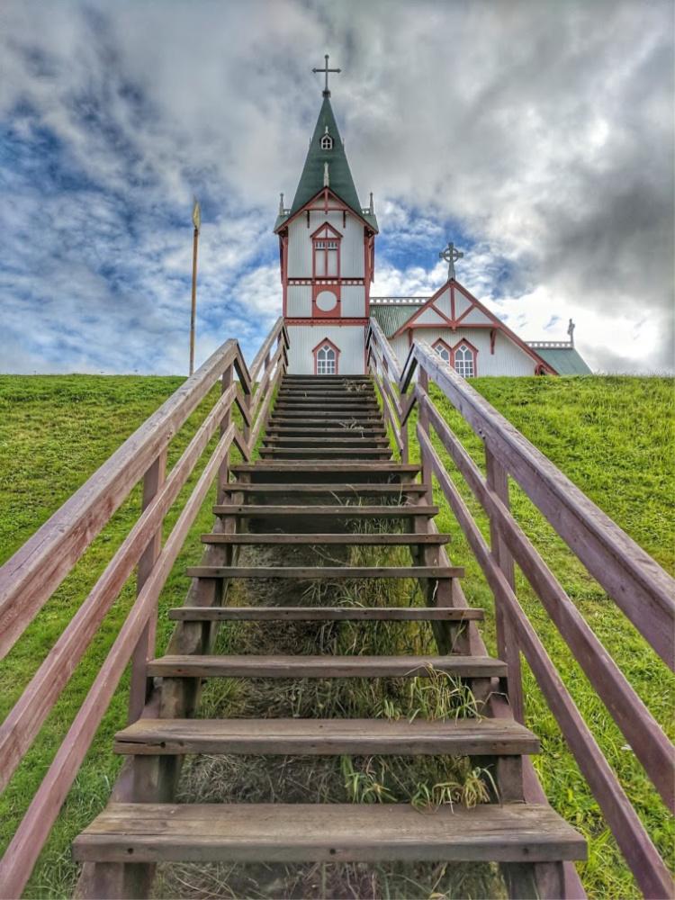 GeoSea - visiting new geothermal pools in Iceland. Husavik church - a stairway to heaven.