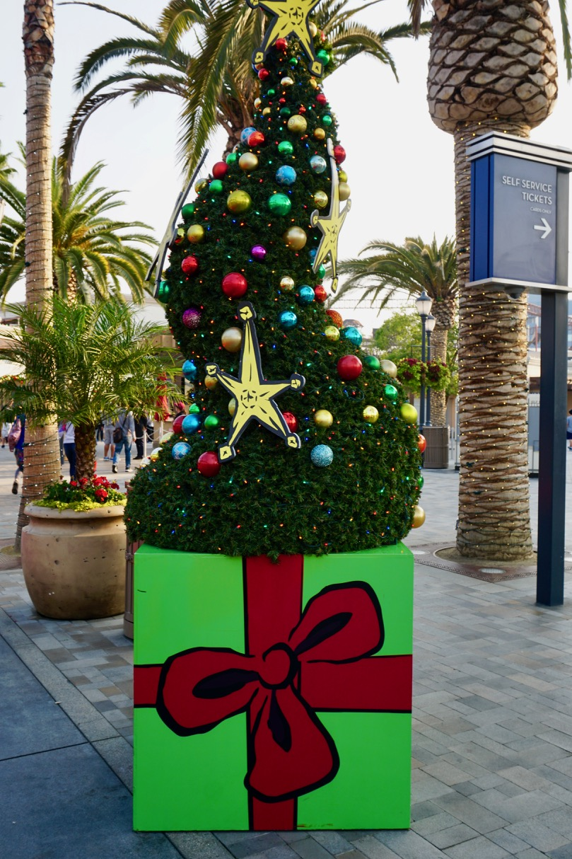 The whimsical, Dr. Seuss-inspired Christmas trees during Grinchmas at Universal Studios Hollywood is one of the reasons to visit during the holidays with young kids. Photo by Multidimensional TravelingMom, Kristi Mehes.