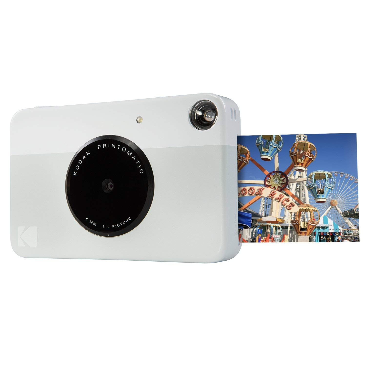 The Kodak Printomatic Camera is the best accessory to take along with travel journals. You can print the picture and add it in during your trip.