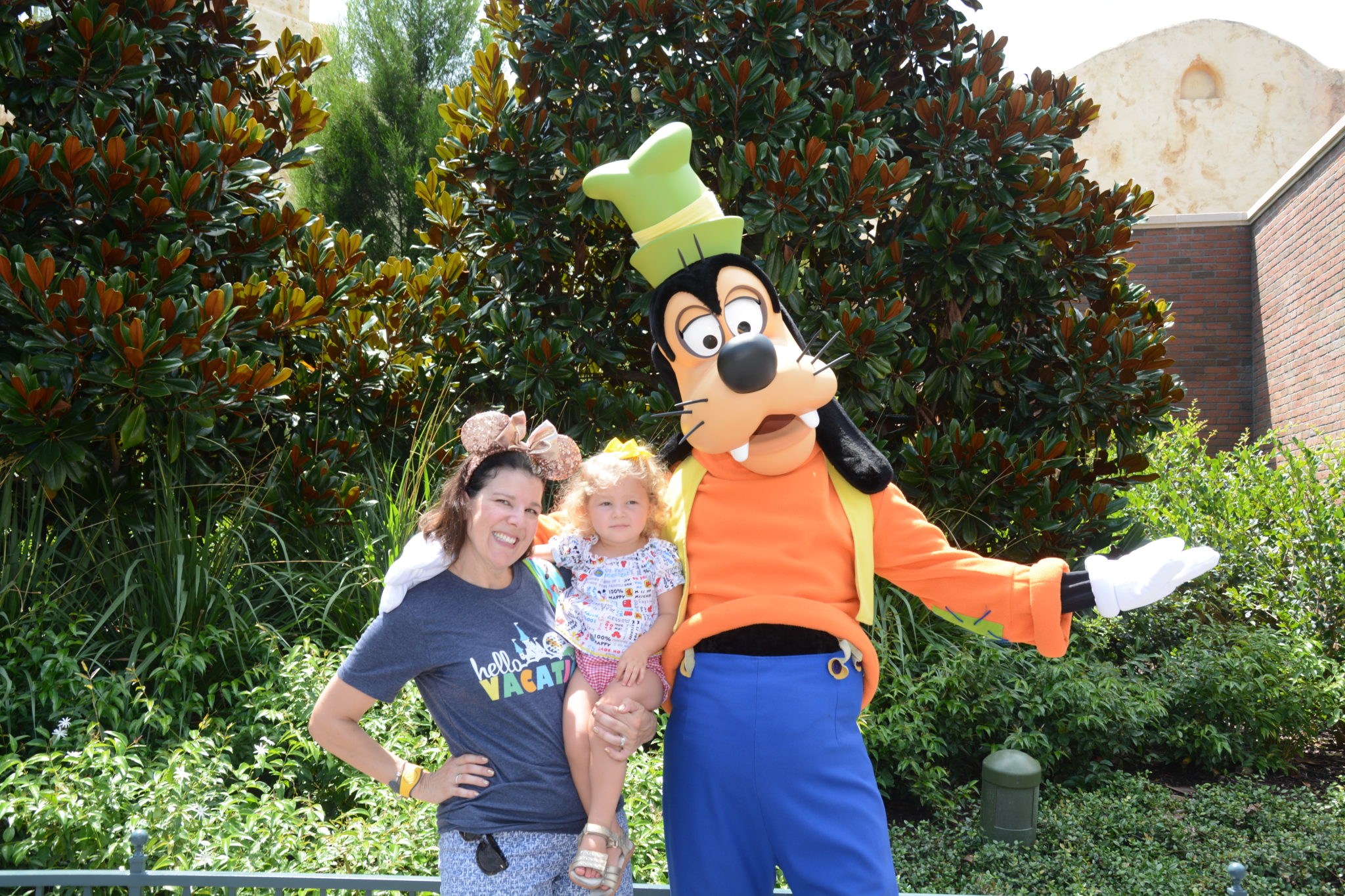 mom and toddler meet Goofy at Disney's Hollywood Studios - TravelingMom