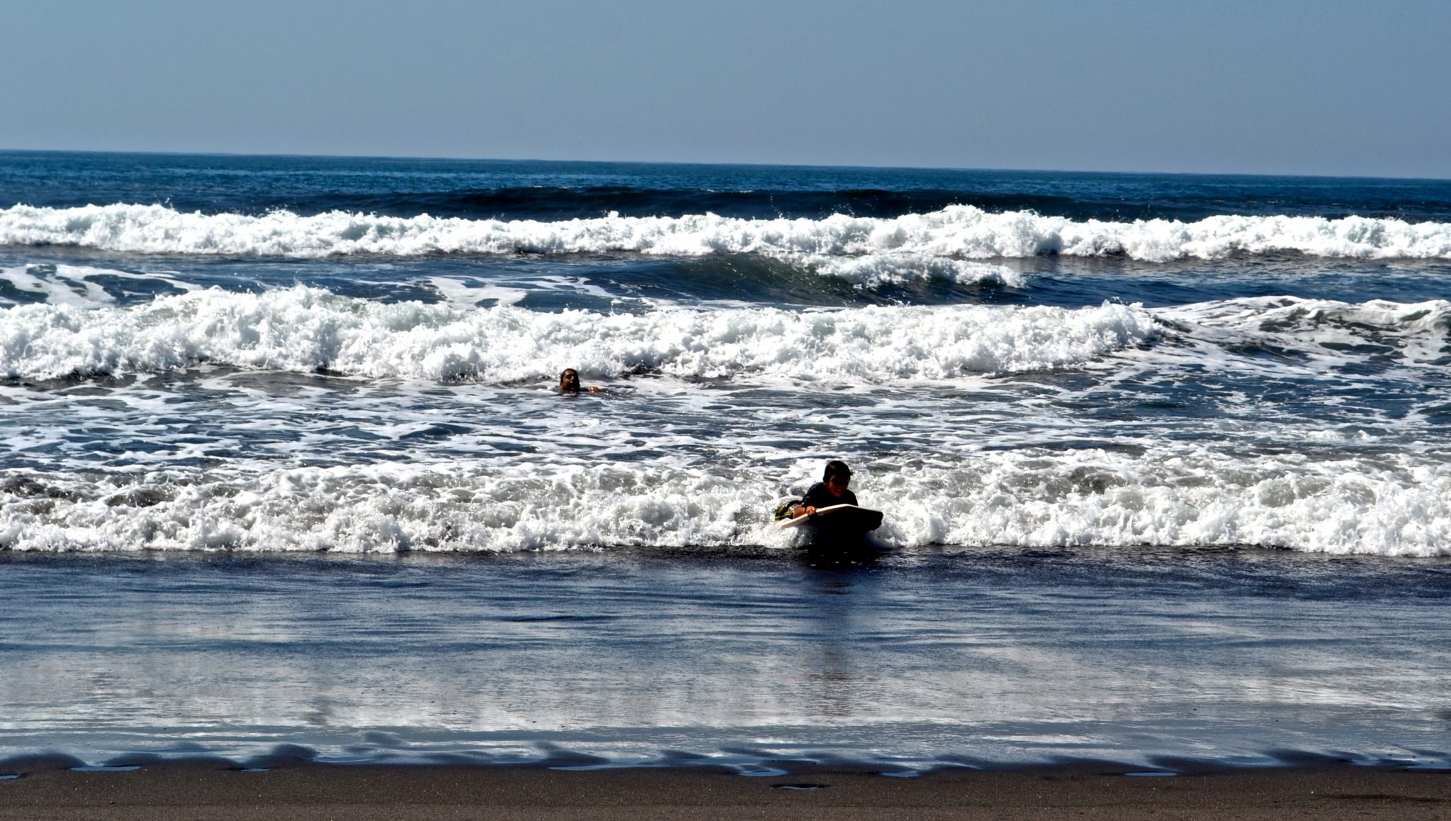 Best Beaches in Central America for Families: Learning how to surf at El Paredon in Guatemala