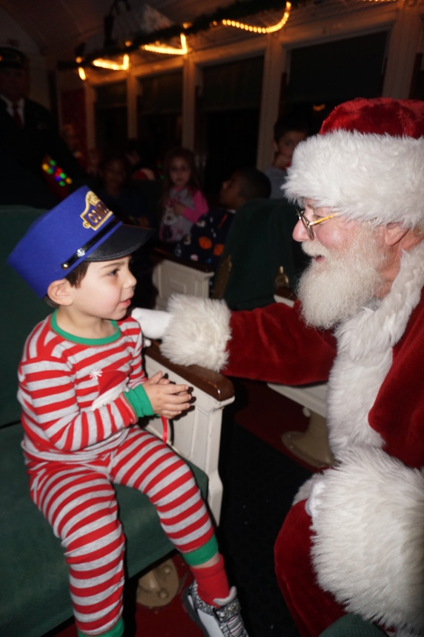 Santa makes an appearance on the train when you take a ride on the Polar Express in Arizona. Photo by Multidimensional TravelingMom, Kristi Mehes.