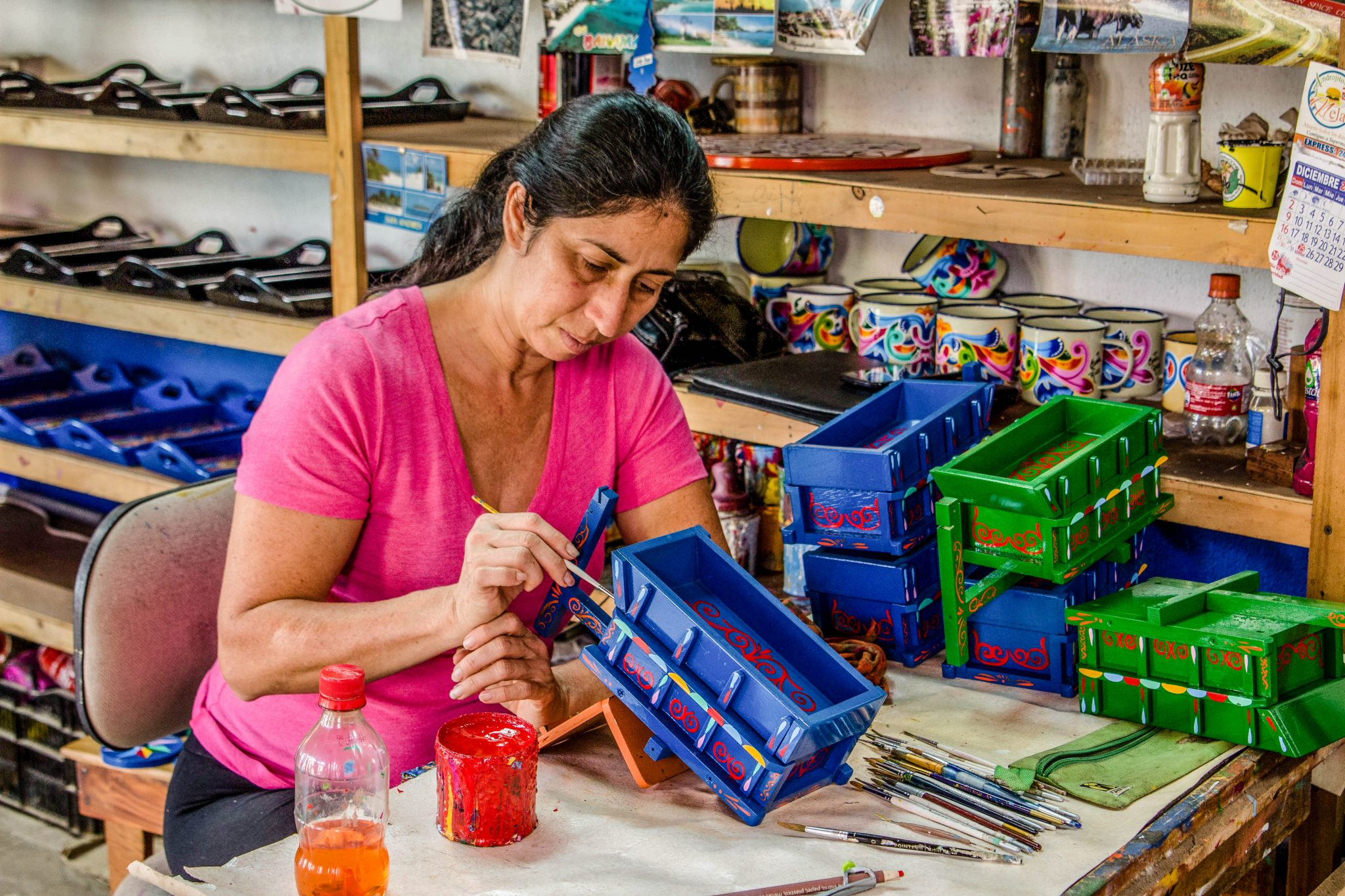Watching artisans paint oxcarts is one of the many things to do in Costa Rica with kids