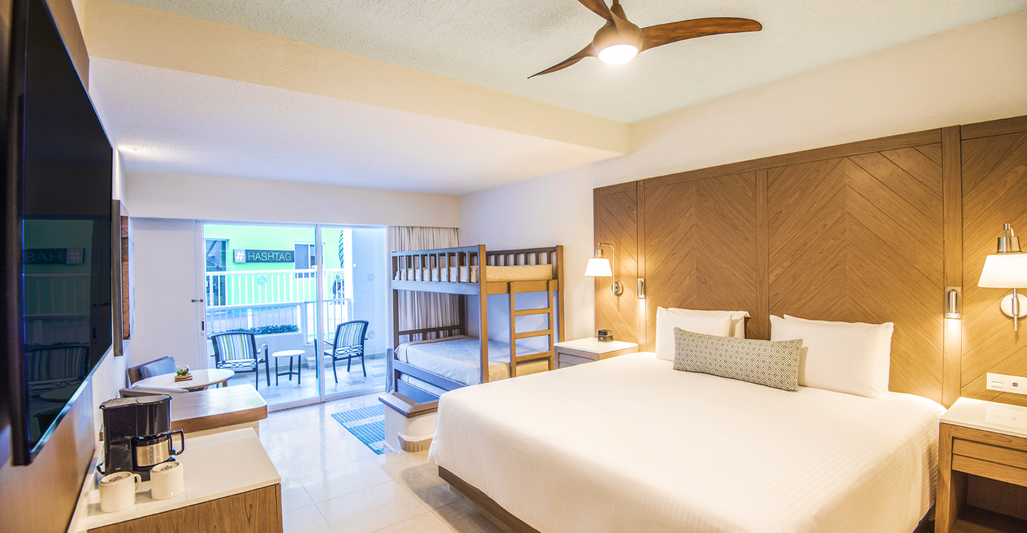 With easy access to Camp Jack, these 387 sq ft suites can accommodate up to two adults and three kids, with twin bunk beds and a trundle bed in addition to a king-size bed. Your private furnished terrace or balcony comes with a hammock, perfect for lazy days. Photo Credit: Panama Jack Resorts Cancun