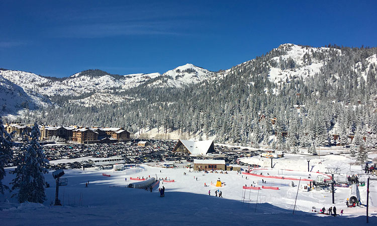 Views of the lake while carving the perfect turns makes Squaw Valley a top family ski resort.