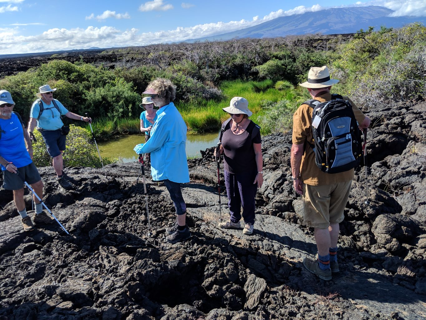 Hiking over the lava fields on Floreana in the Galapagos Islands.