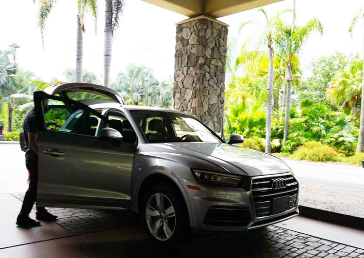 The valet readying Mountain TravelingMom's Silvercar by Audi, making travel easier and earning a tip.