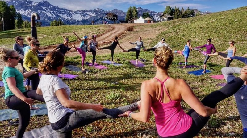 Yoga mats that travel cope with mountains, grasses and rocks.