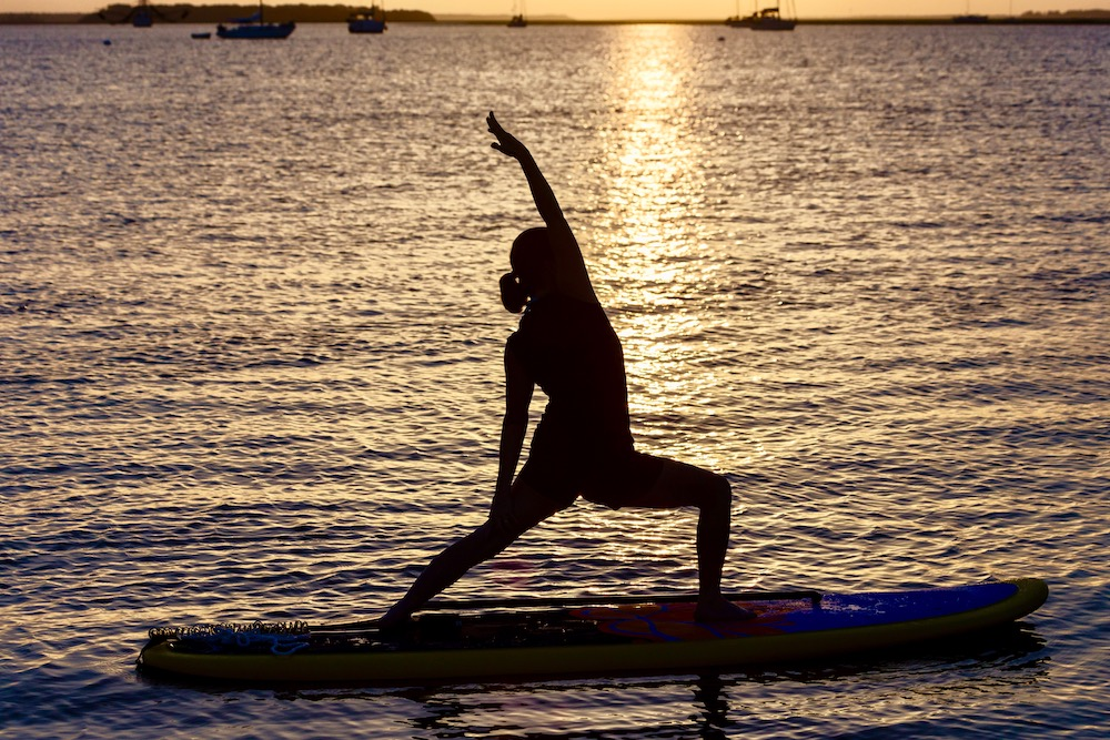 Yoga mats for travel unfurl for sunrise and sunset.