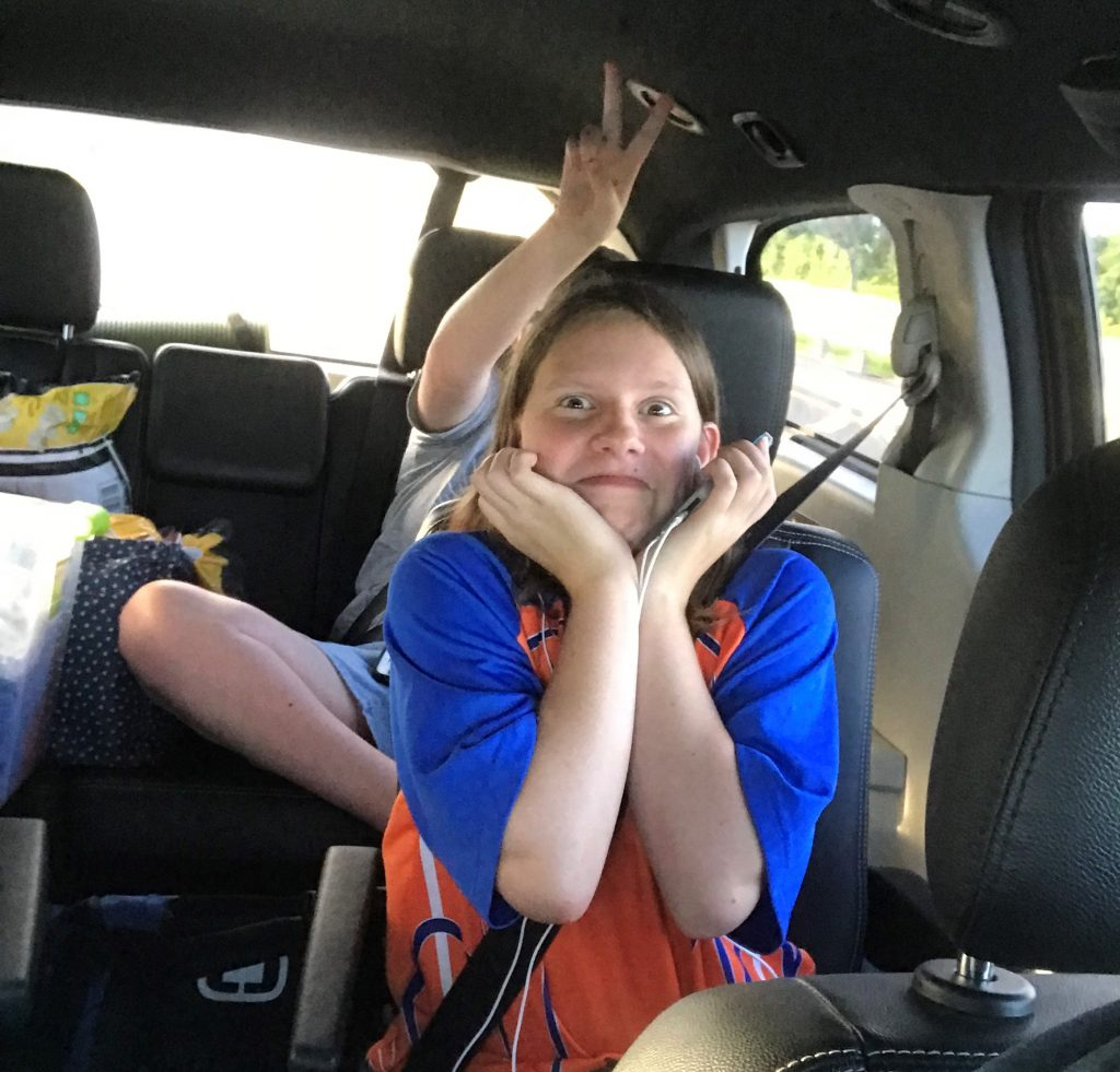road trips with teens and tweens. Kids being goofy.