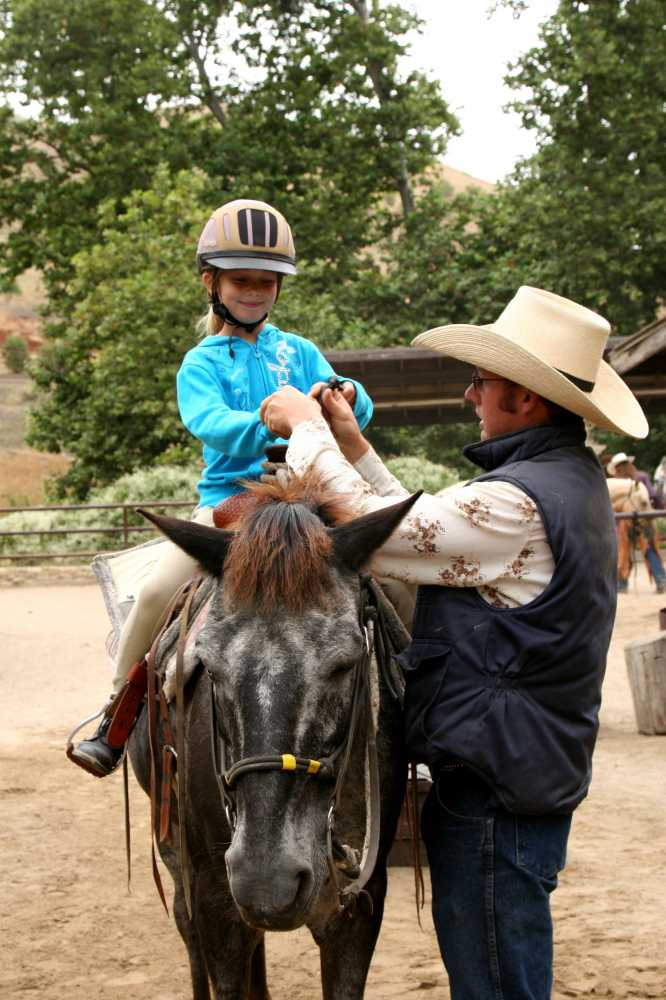 Best dude ranches for families offer kids a chance to ride and care for horses.