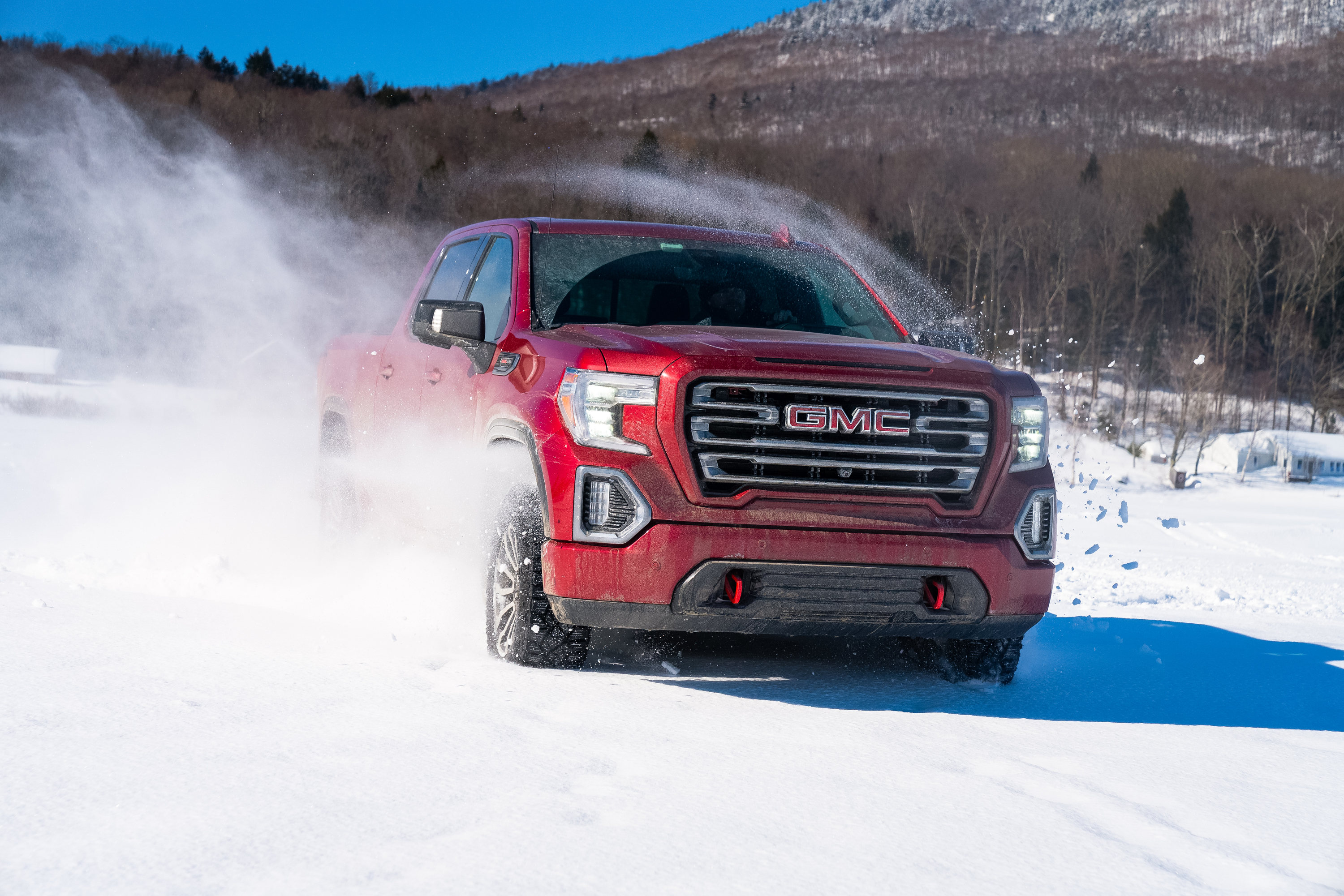 Winter driving tips: try a Red GMC Sierra on snow covered lake in Stowe VT