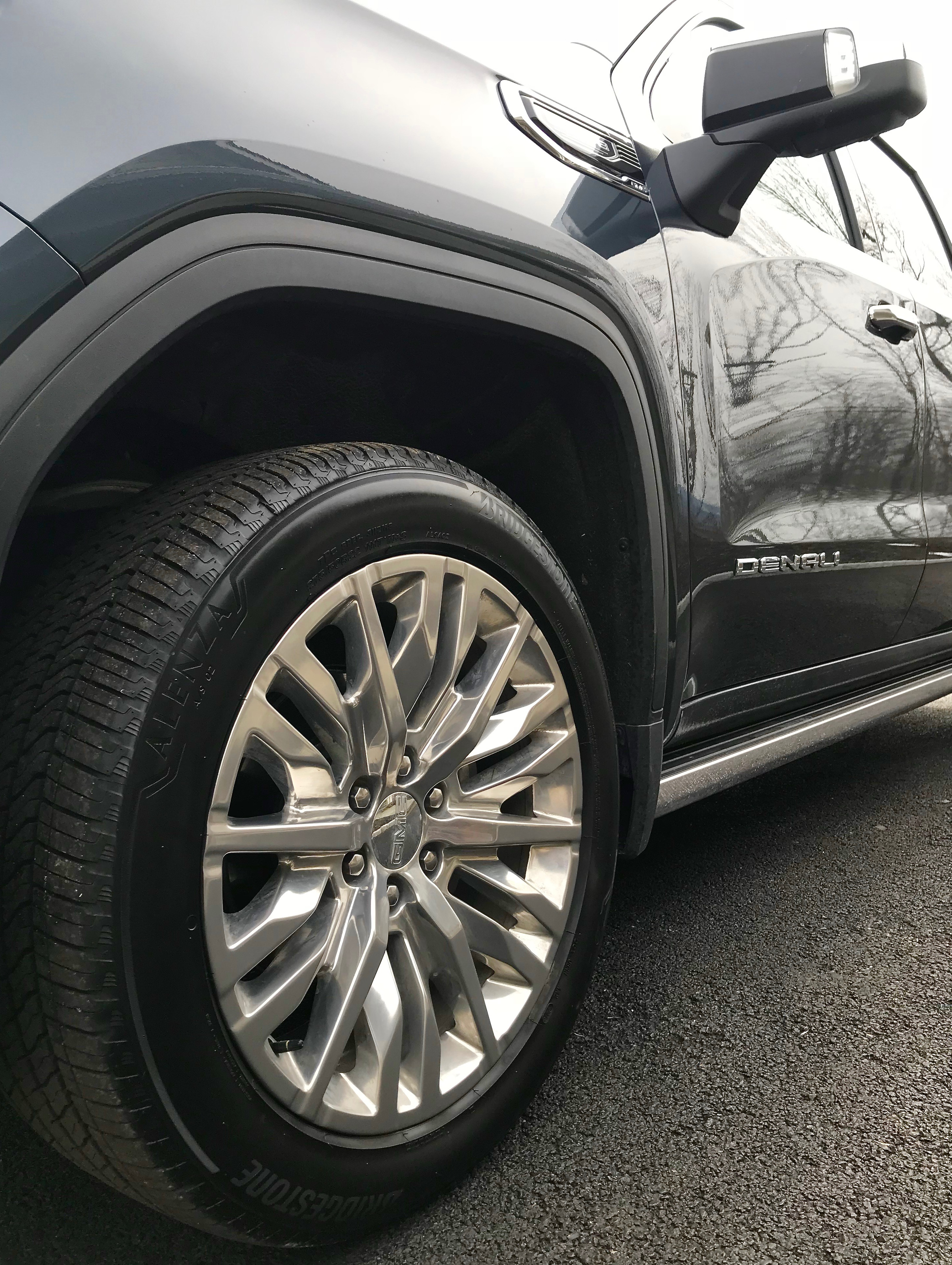 One of my favorite winter driving tips: performance tires with sculpted rims on GMC Sierra Denali - having the right tires is an important winter driving tip
