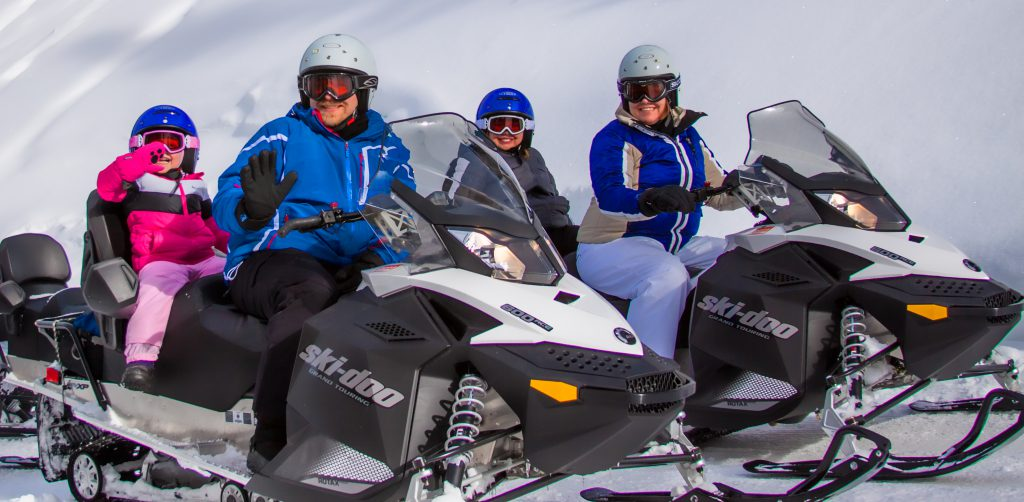 Grand Lake offers more than 100 miles of trails for intermediate to advanced snowmobiling. Photo: Grand Adventures