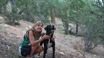 dog and woman on a hike - TravelingMom