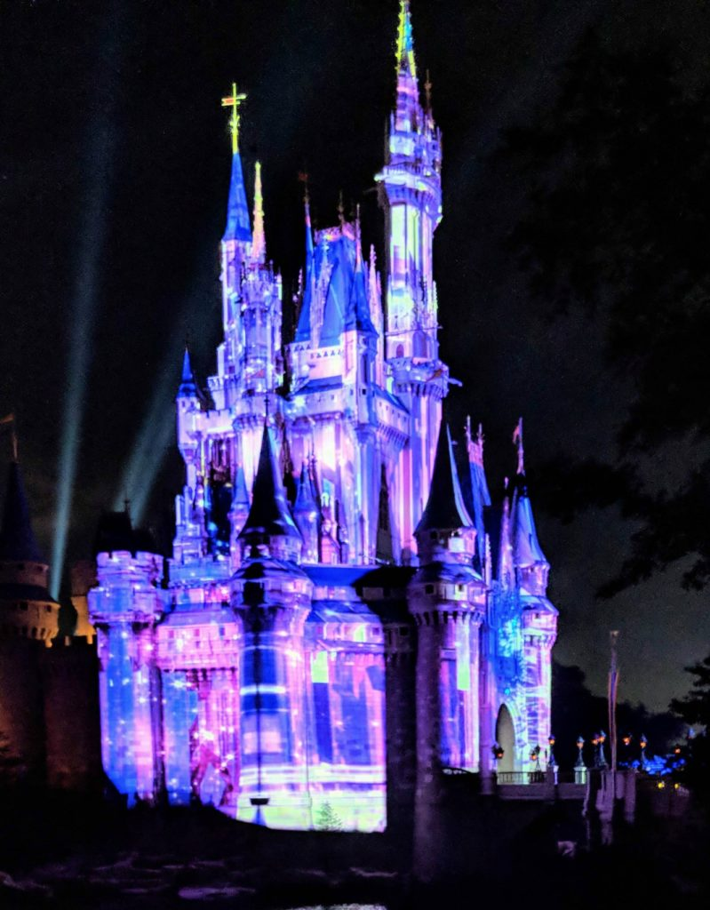Magic Kingdom's Cinderella Castle at night - TravelingMom