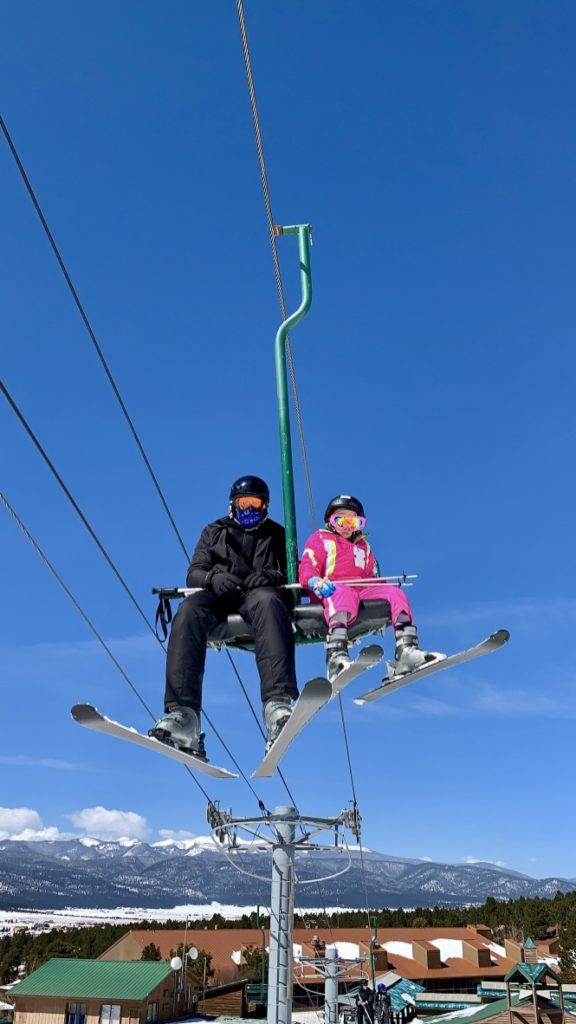 Riding the ski lift at the ski resort in New Mexico.