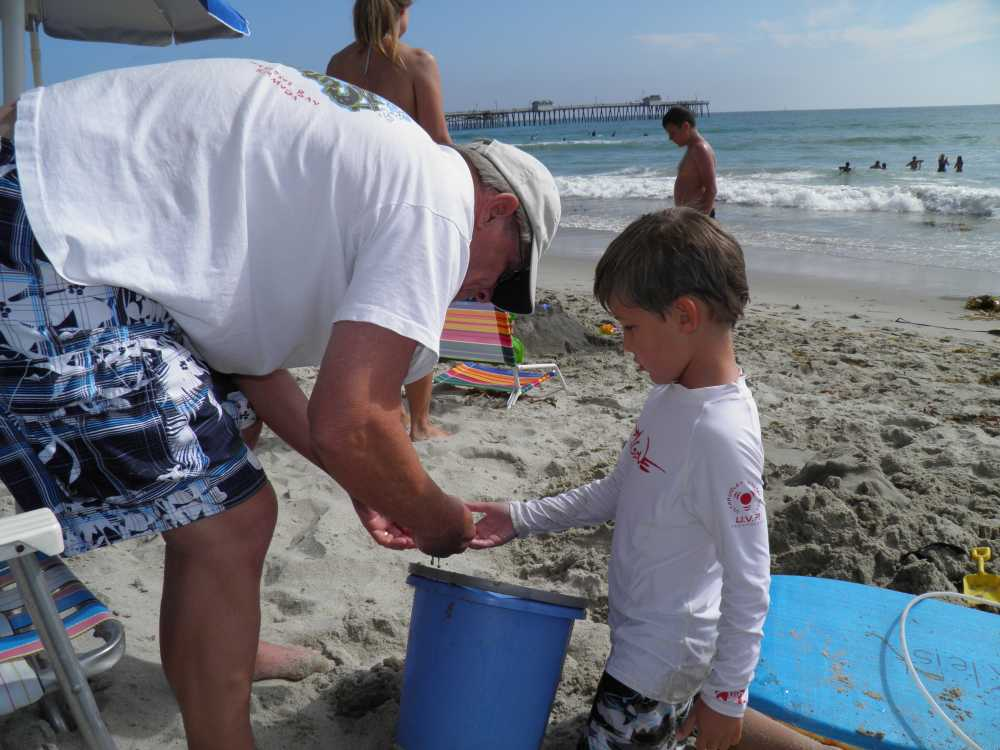 A simple bucket can be used for many beach games and activities