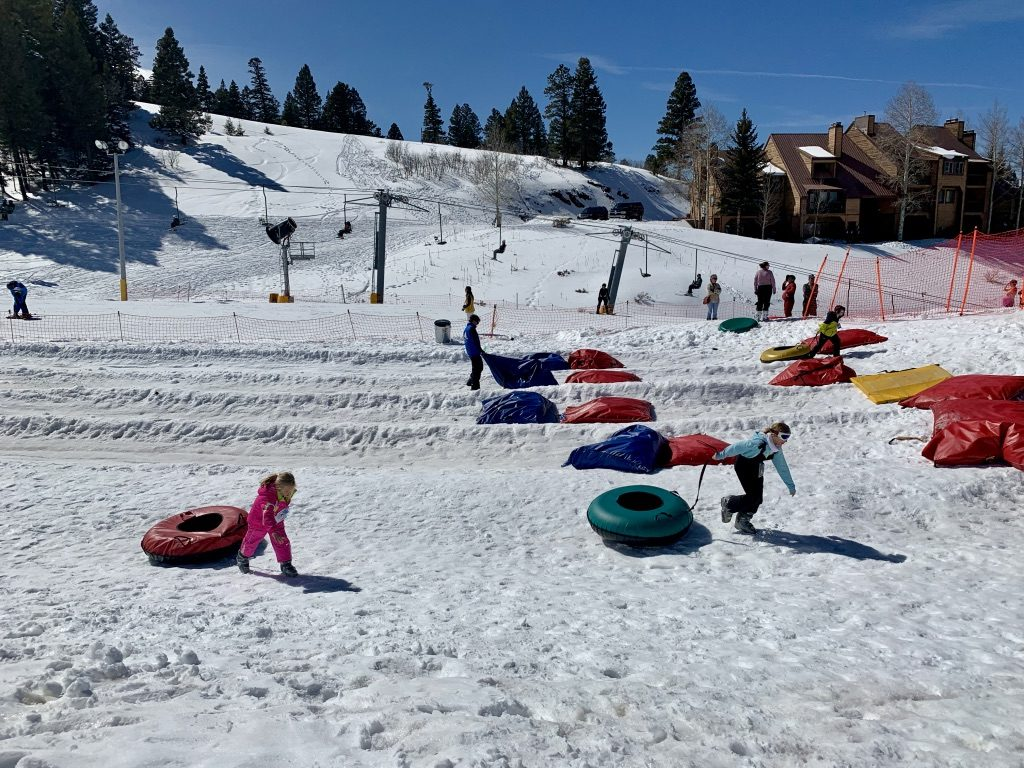 Snow tubing a fun activity at a ski resort in New Mexico.