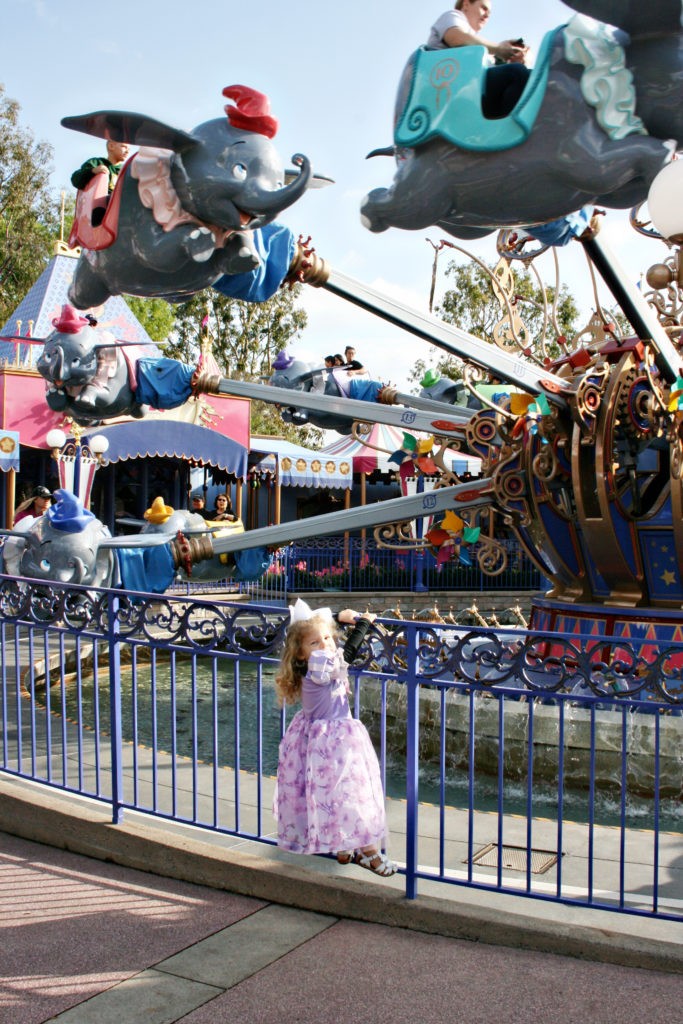 Disneyland Dumbo attraction with toddler