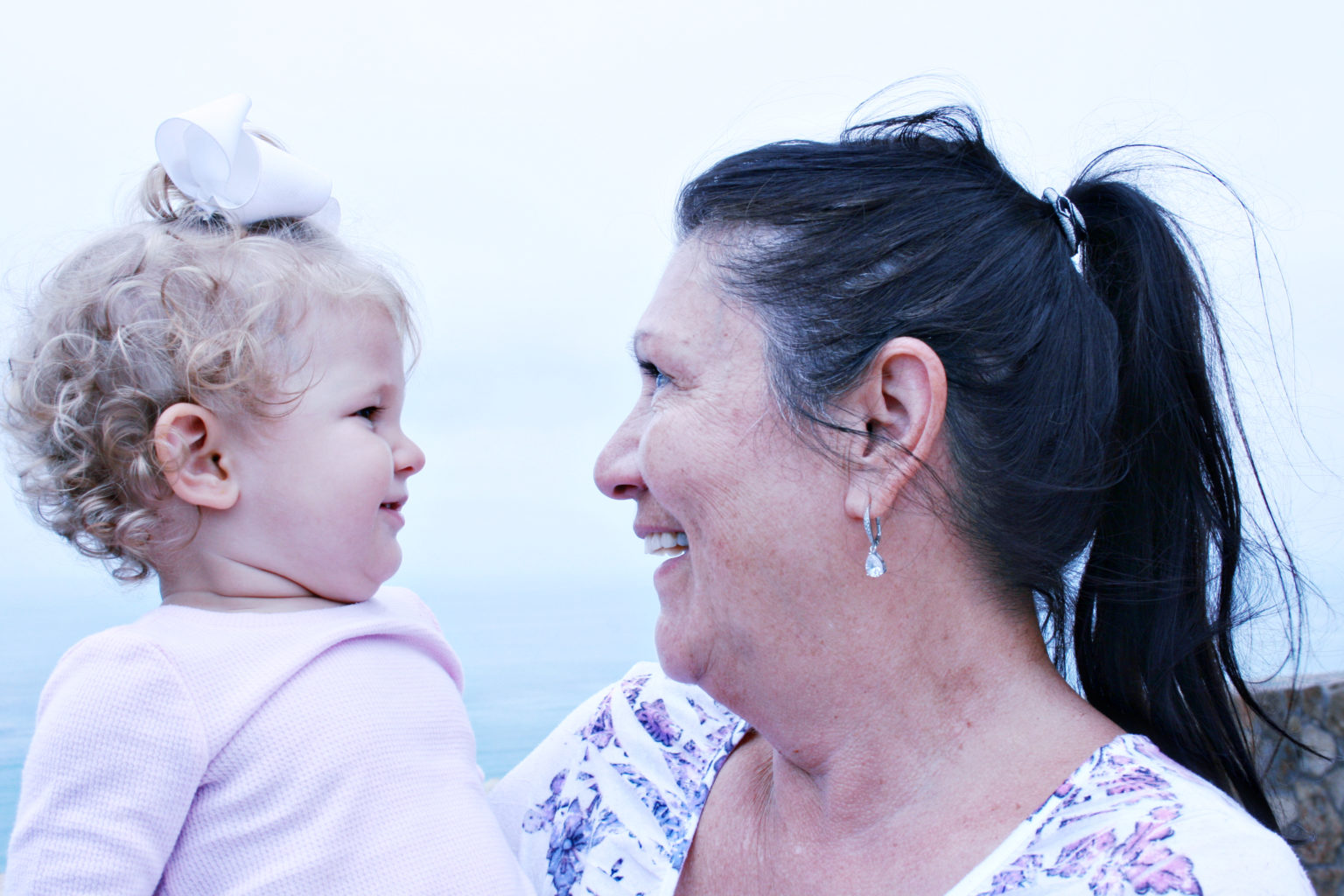Smiling toddler and grandmother - TravelingMom
