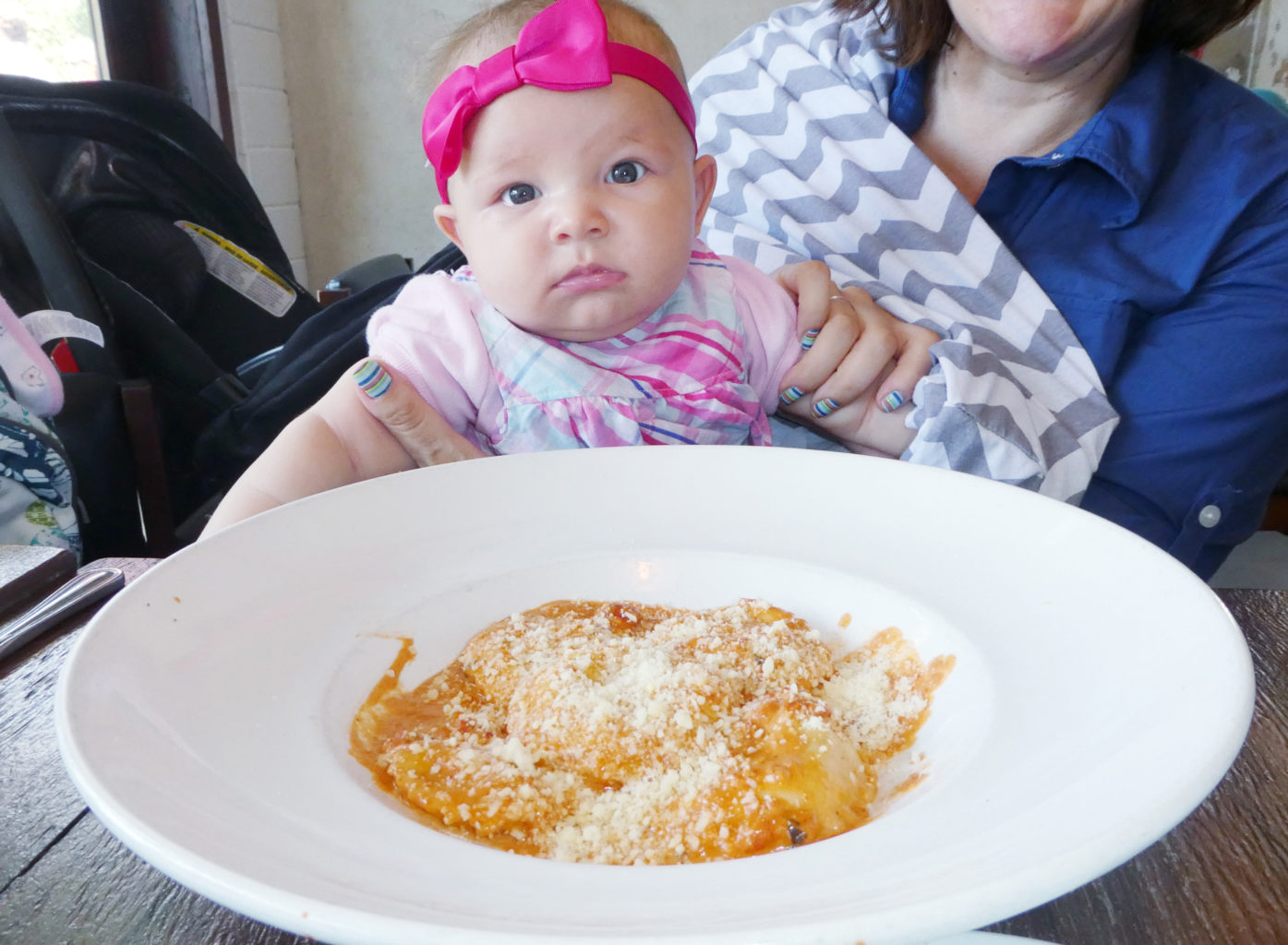 Nursing baby while traveling in a restaurant - TravelingMom