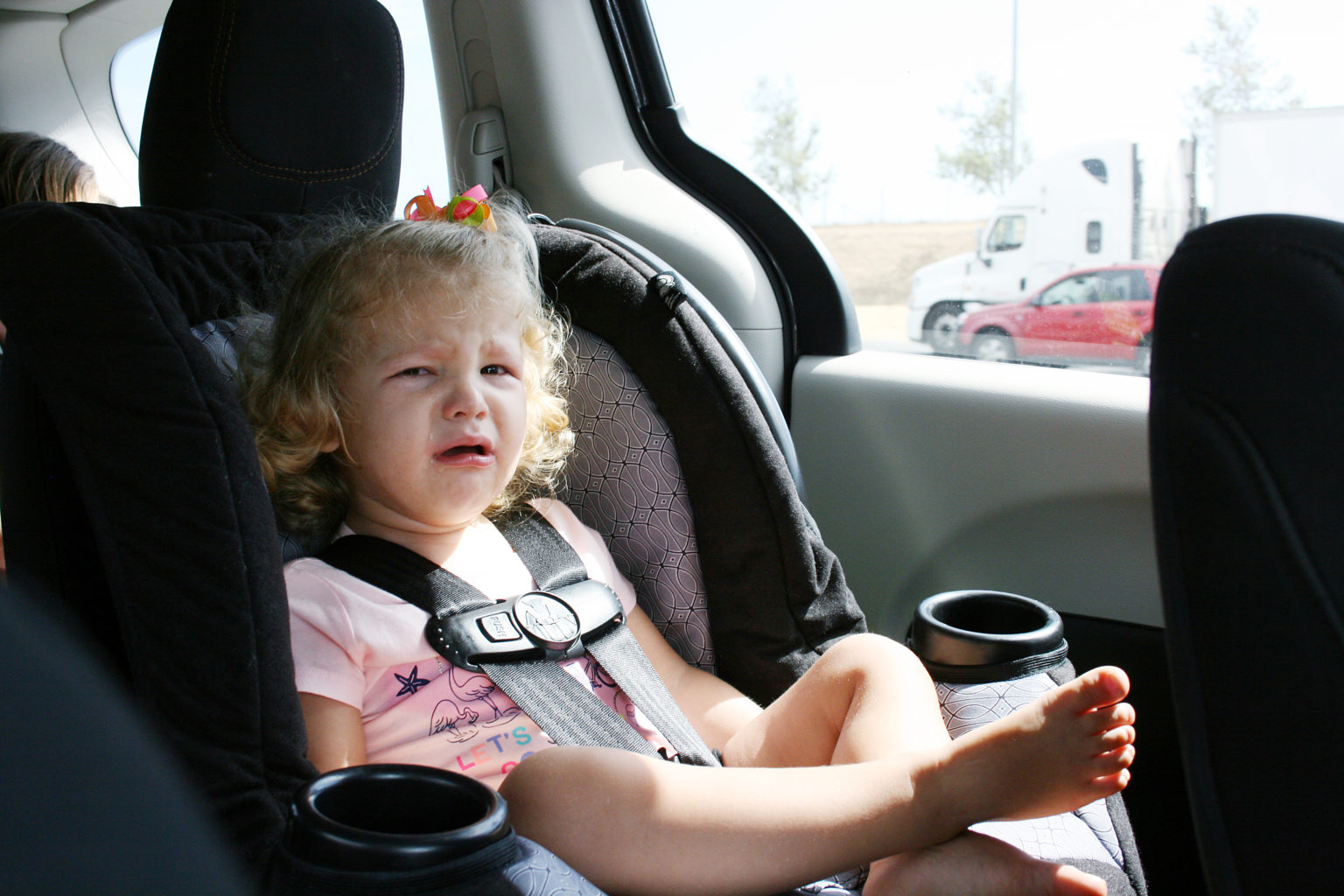 Cranky toddler on a road trip