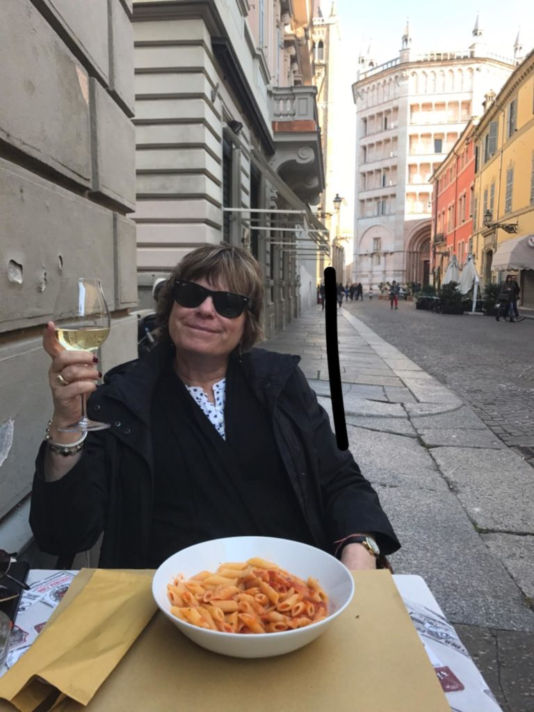 Enjoying a bowl of pasta in Parma.