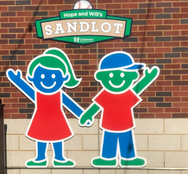 Hope and Will are ready to welcome all their friends to play in the Sandlot with them at Braves games. Photo Credit: Kendra Pierson, Long Weekend TravelingMom