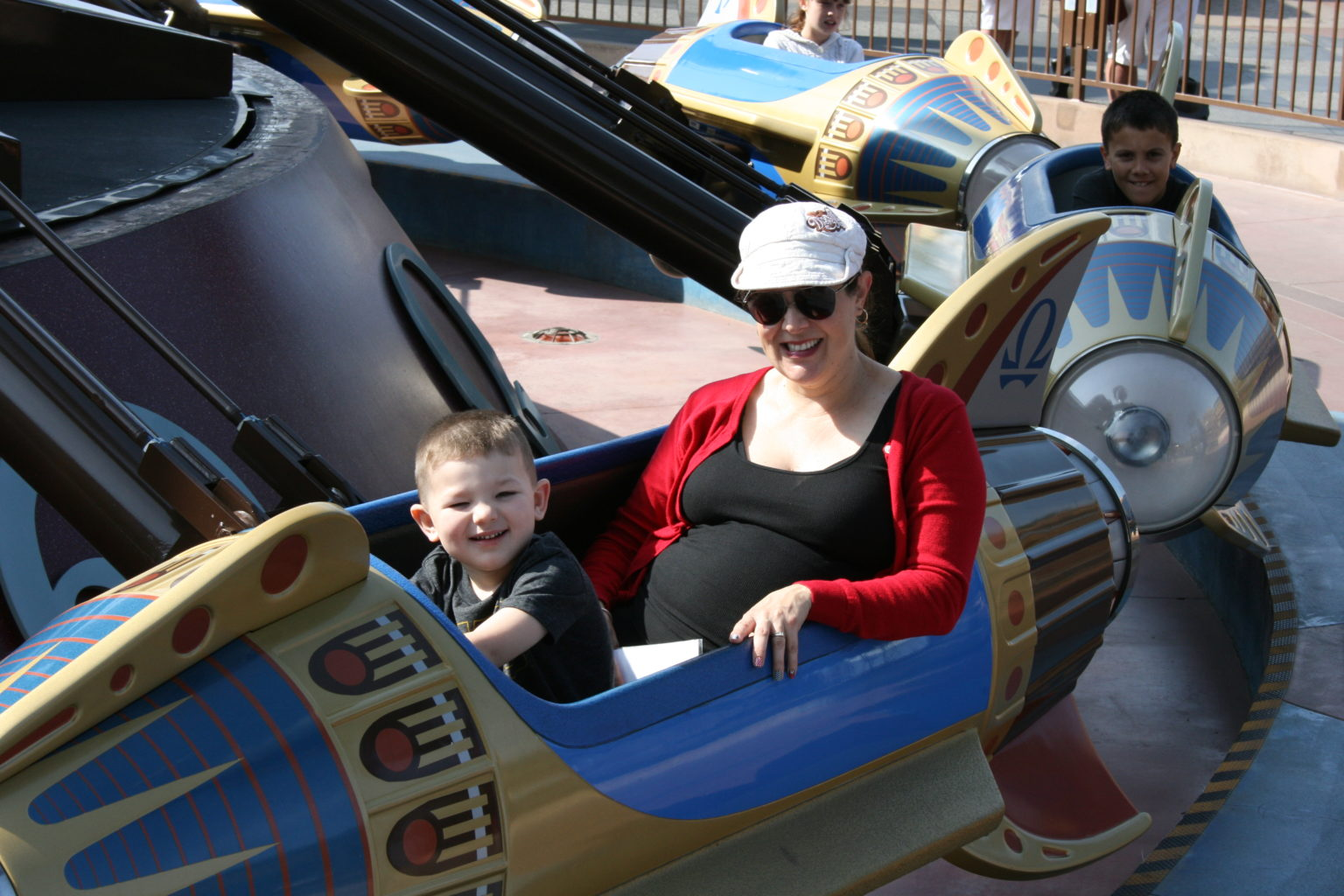 Pregnant mom and son riding Astro Orbitor at Disneyland - TravelingMom