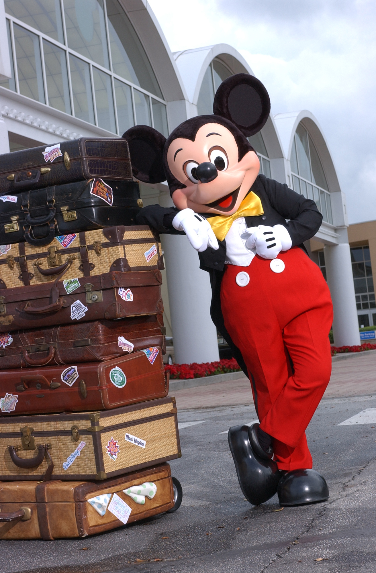 Mickey Mouse with luggage at Orlando airport