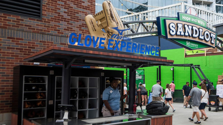 Families can borrow a glove for free at the Mizuno Glove Experience at the Atlanta Braves baseball game. Photo: Atlanta Braves