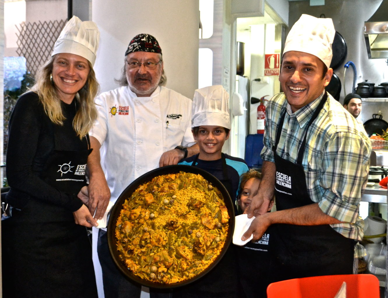 Family paella cooking tour and meal in Spain.