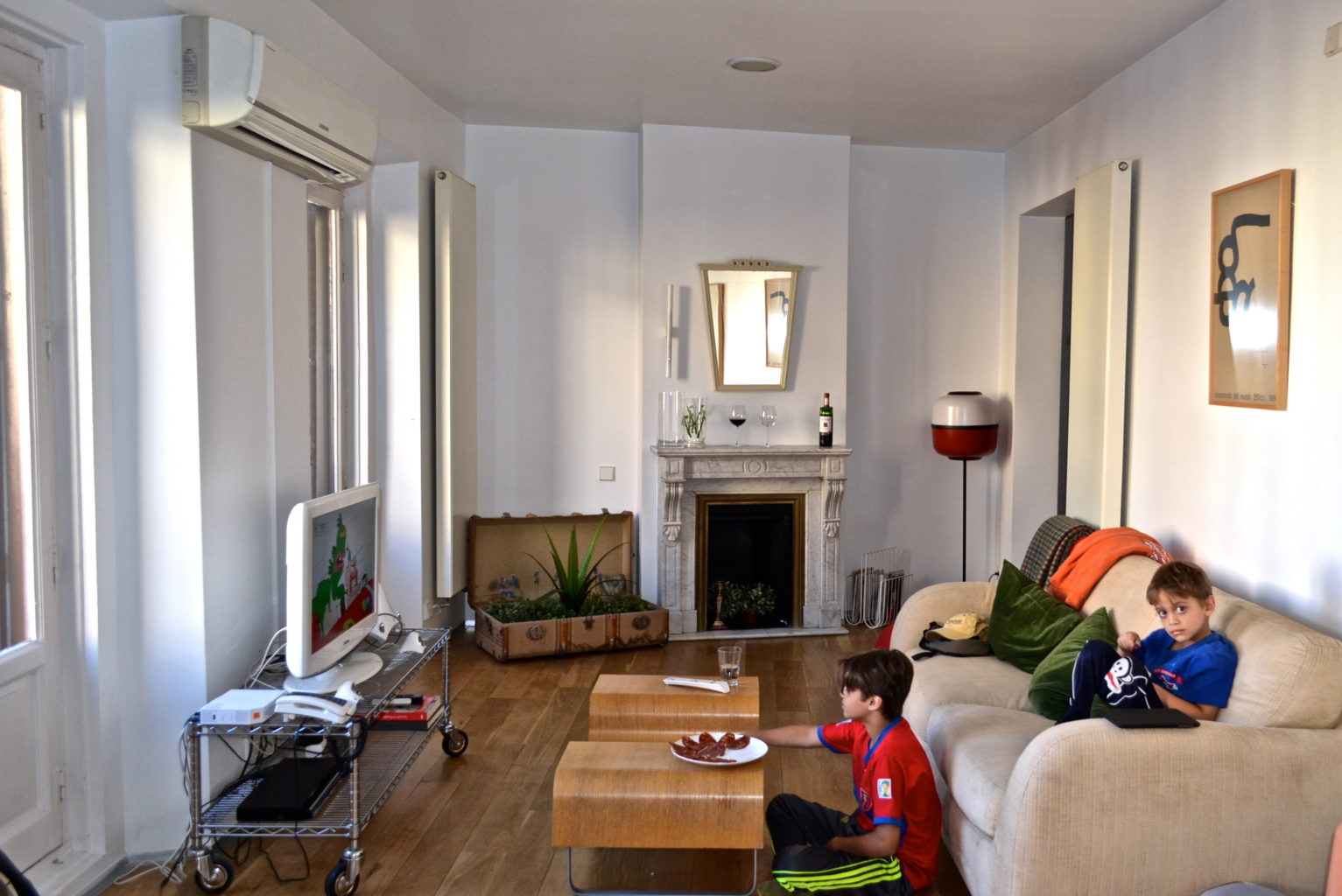 Boys in an Airbnb living room - TravelingMom