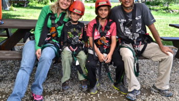 Family ready to go ziplining - TravelingMom