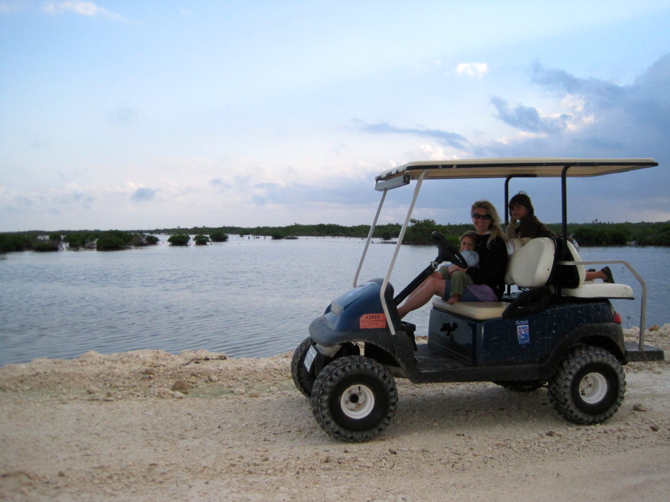 Family in a dune buggy on the beach - TravelingMom