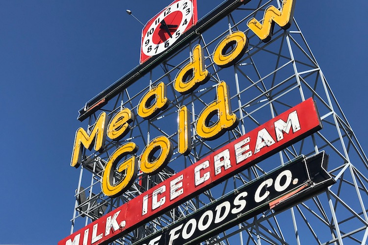 The Meadow Gold sign in Tulsa Oklahoma features a free display with historical plaques celebrating the history of Route 66.