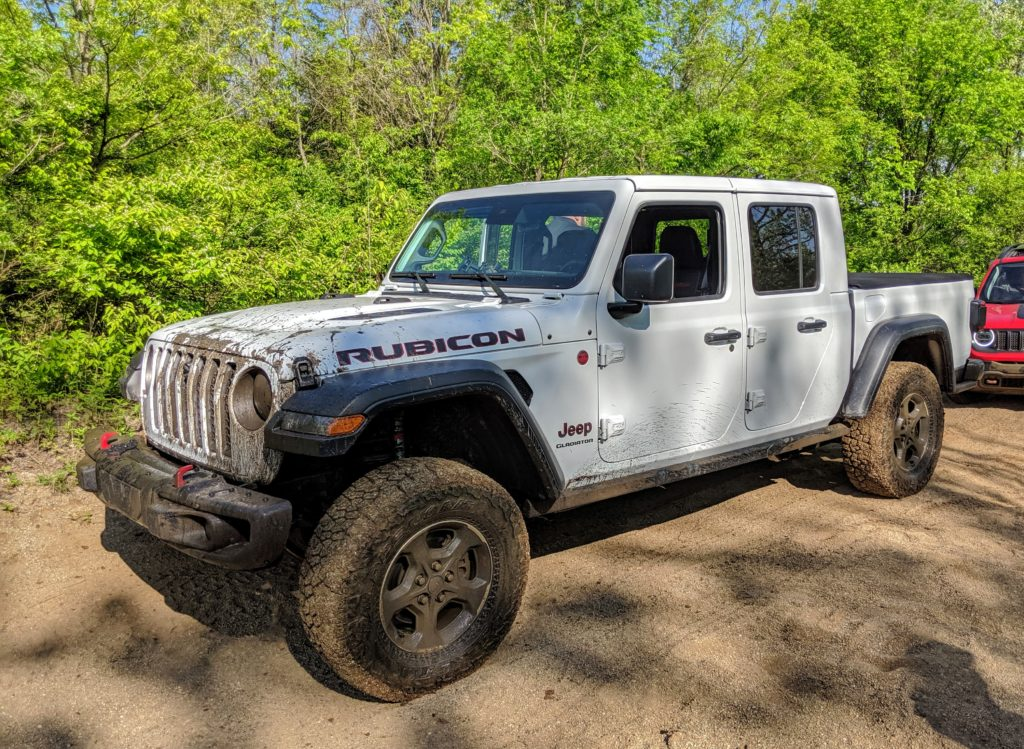 A muddy Jeep Gladiator Rubicon after an off road adventure.