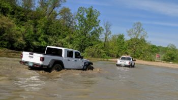 Jeep Gladiator Rubicon fords a stream in an off road adventure at The Badlands.