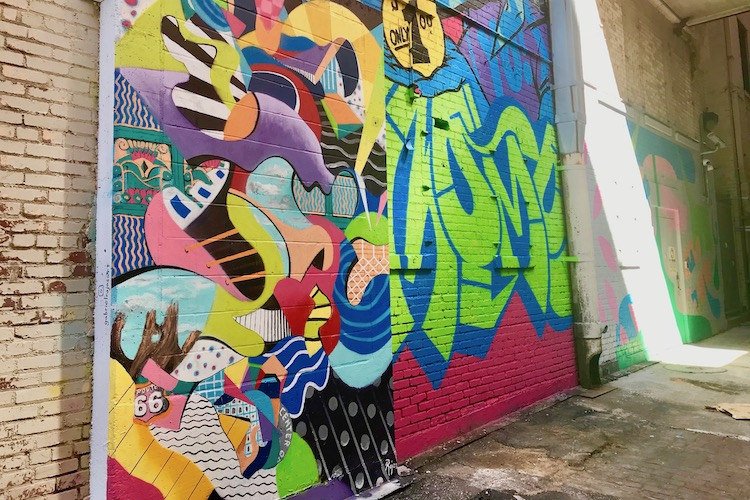 Tulsa art alley mural; posing is a fun, free thing to do in Oklahoma.