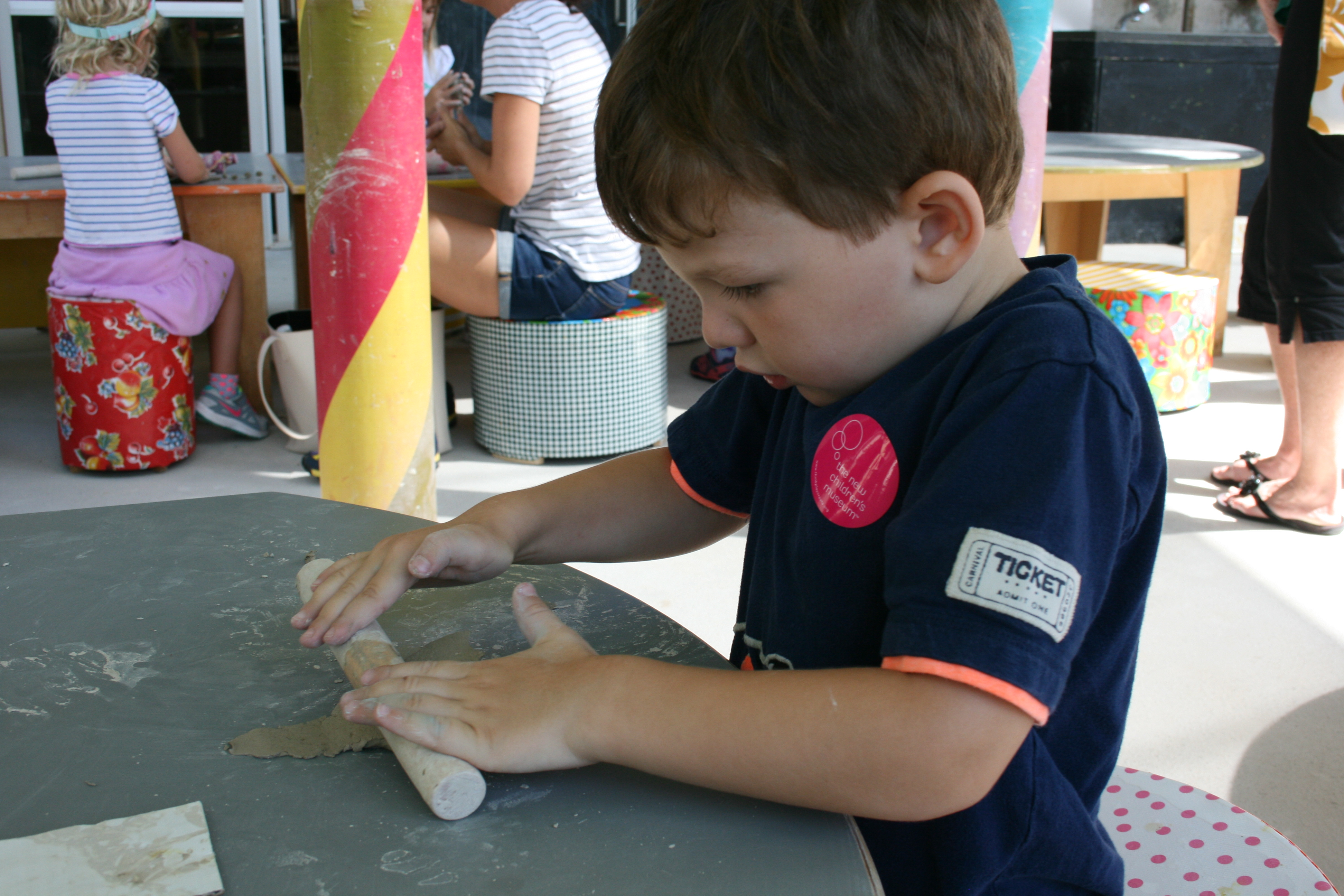 Child using clay at the New Children's Museum in San Diego