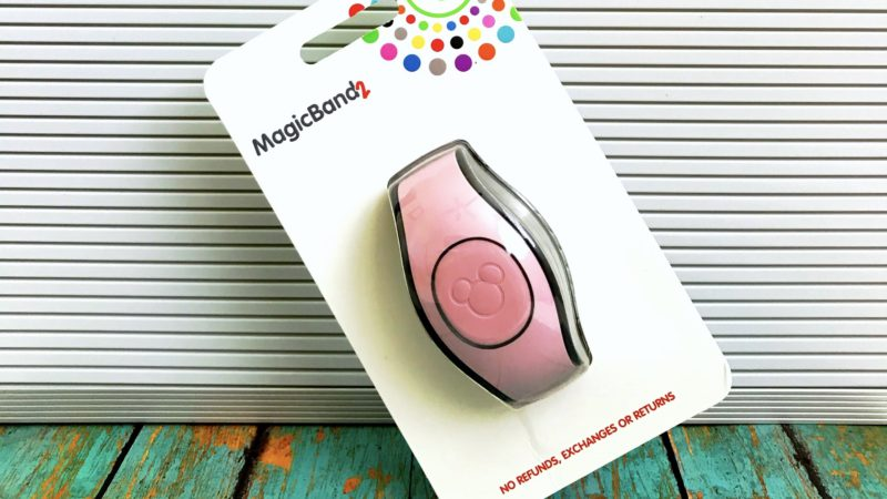 The popular Millennial Pink MagicBand in its original packaging.