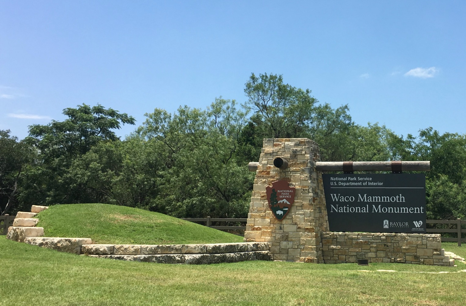 Visit Waco, a super Texas weekend getaway, and the Waco Mammoth National Monument Sign