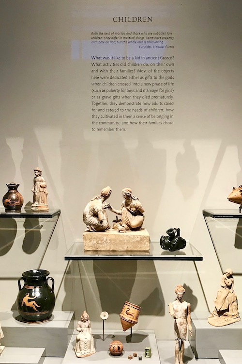 Exhibit at the Boston Museum of Fine Arts featuring children in ancient Greece