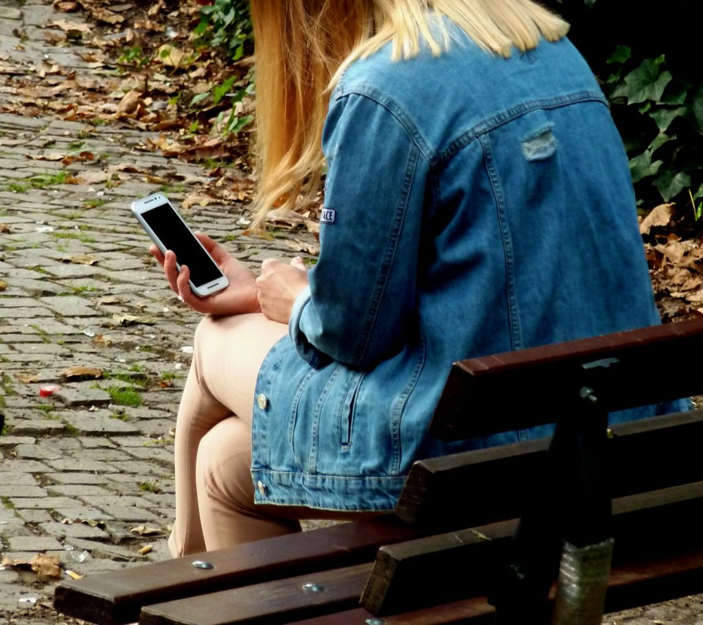 Woman in a park on her cell phone.