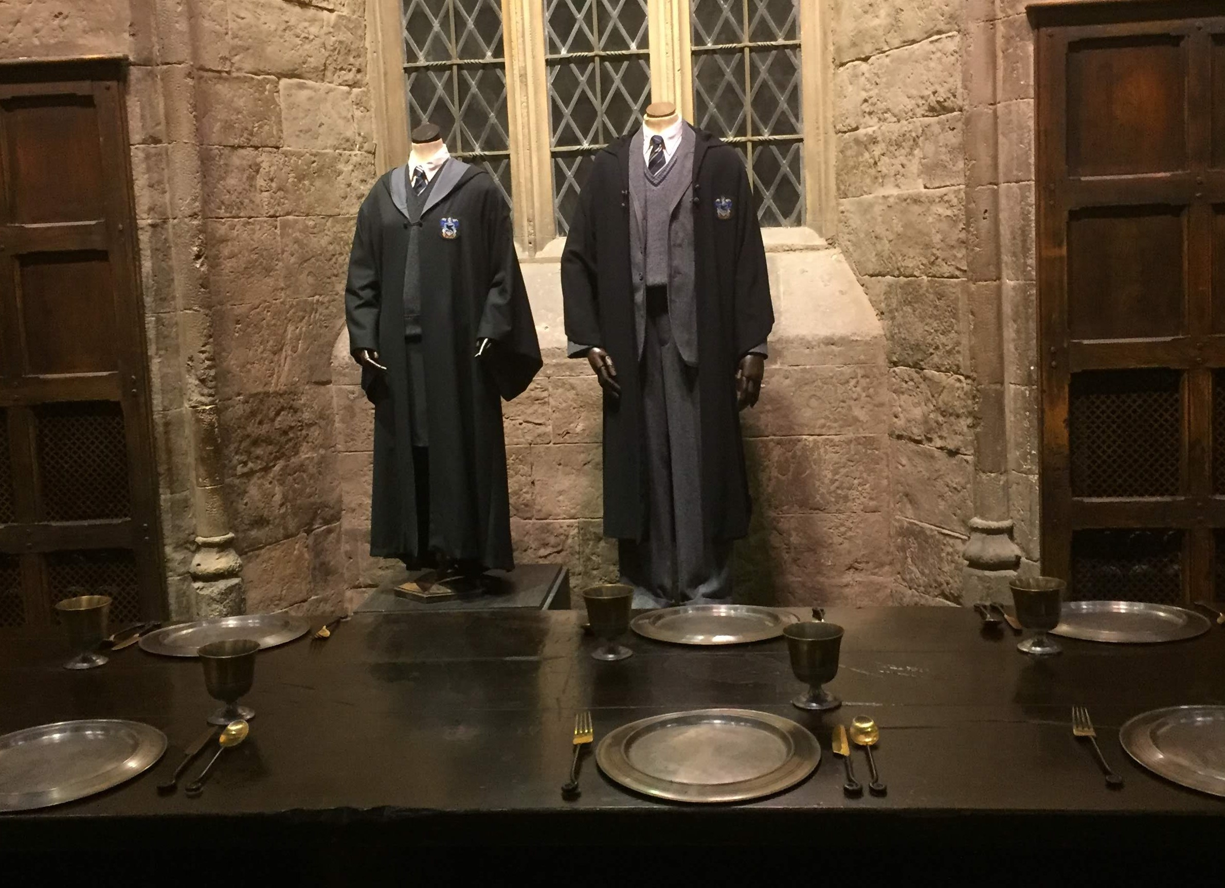 Costumes on display in the Great Hall at the Harry Potter Studio Tour in London