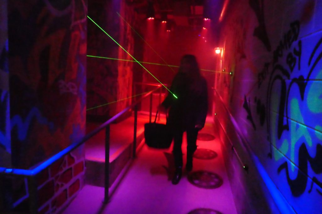Lasers shine on you as you exit Safehouse Chicago, a kid-friendly restaurant in downtown Chicago.