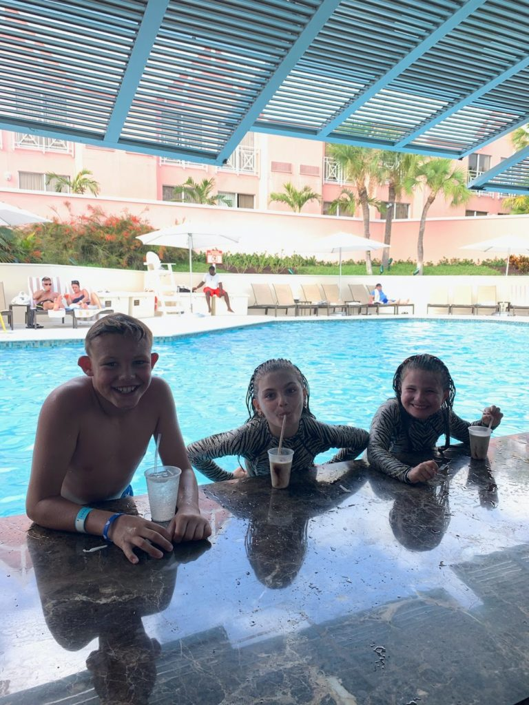 At the end of the day, families at the Comfort Suites Bahamas make new friends at the hotel pool.