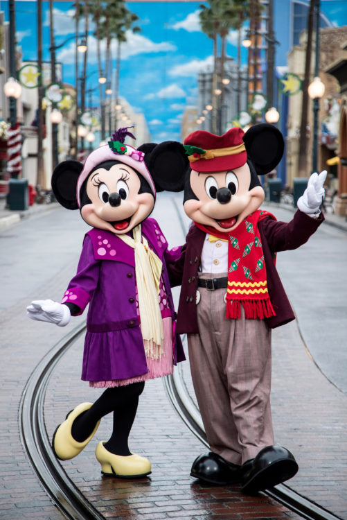Mickey and Minnie Mouse in holiday outfits